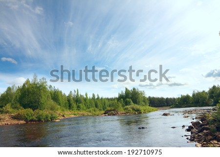 Landscape with forest, river and stones - stock photo