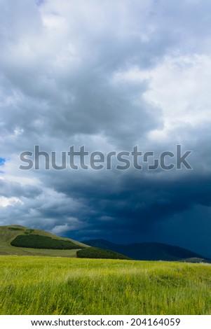 Landscape with gloomy sky - stock photo