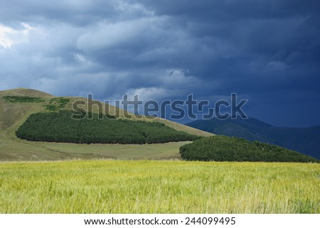 Landscape with gloomy sky - stock photo