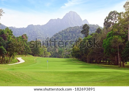 Landscape with Golf course and mountain. - stock photo