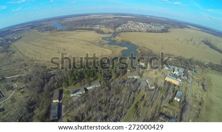 Landscape with health camp for children and field in the spring day, aerial view - stock photo