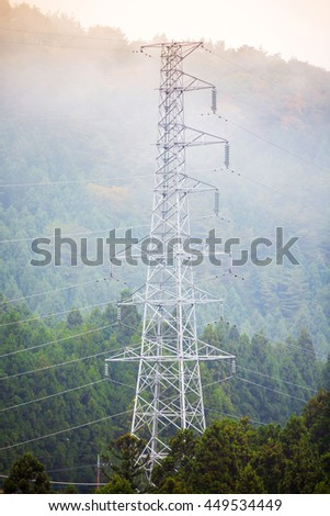 landscape with high voltage transmission towers - stock photo