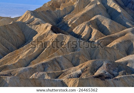 Landscape with hikers in upper left corner of Golden Canyon, Death Valley National Park, California, USA