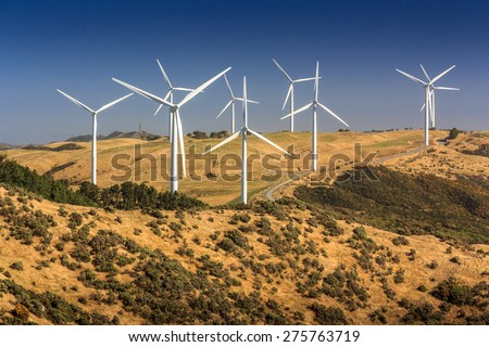 landscape with hills and wind turbines - stock photo