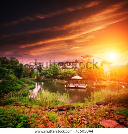 Landscape with house on lake with sunset - stock photo