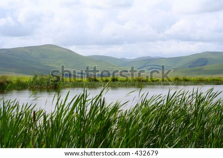 Landscape with lake and hills in the Scottish Borders, UK - stock photo