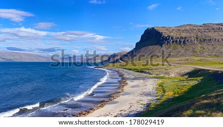 Landscape with low tide at Iceland ocean coast. Panorama. - stock photo
