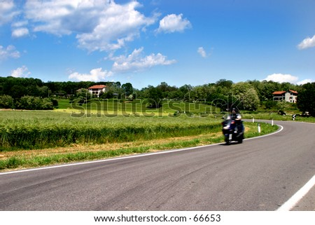 landscape with motorcyclist