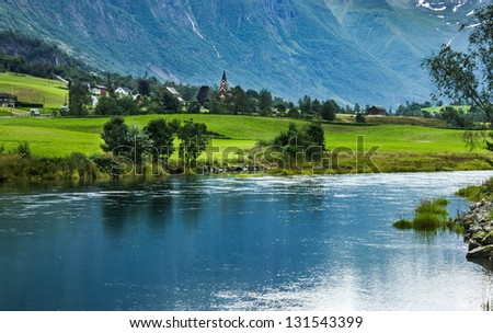 Landscape with mountain and lake in Norwegian village Olden. - stock photo