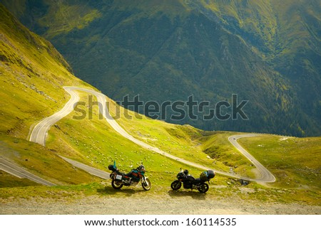 Landscape with mountain road and two motorbikes - stock photo