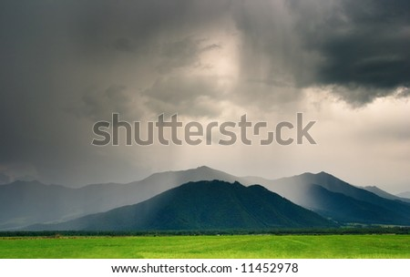 Landscape with mountains and cloudy sky