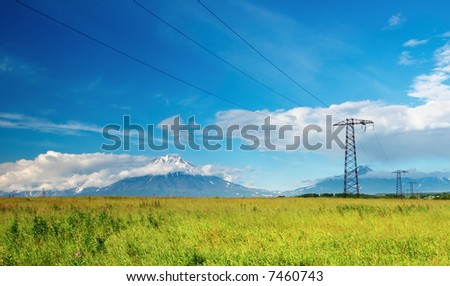 Landscape with mountains and electric power line - stock photo