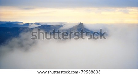 Landscape with mountains and mist. - stock photo