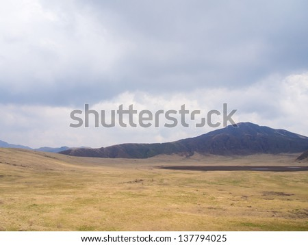 Landscape with mountains and storm clouds - stock photo