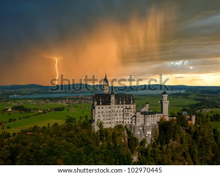 Landscape with Neuschwanstein castle. Thunderstorm with rain and lightning on background - stock photo
