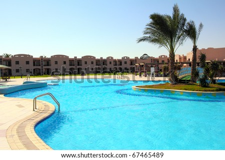 landscape with nobody swimming pool in hotel - stock photo