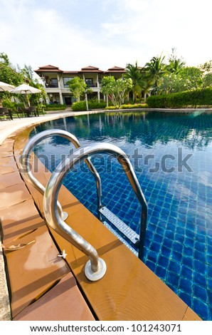 Landscape with pool views and house - stock photo