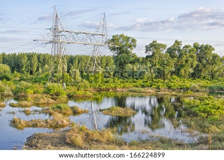 Landscape with power line in background. - stock photo