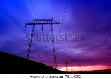 landscape with pylon and cable early morning