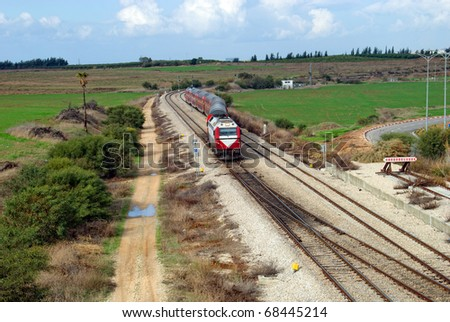 landscape with railway and train - stock photo