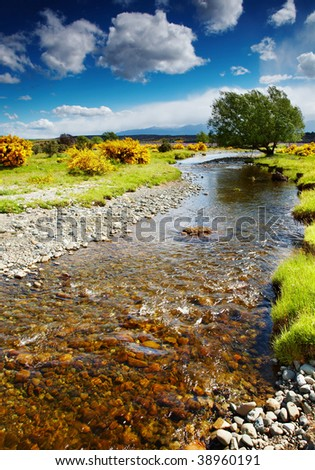 Landscape with river and blue sky - stock photo