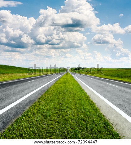 landscape with road and cloudy blue sky - stock photo