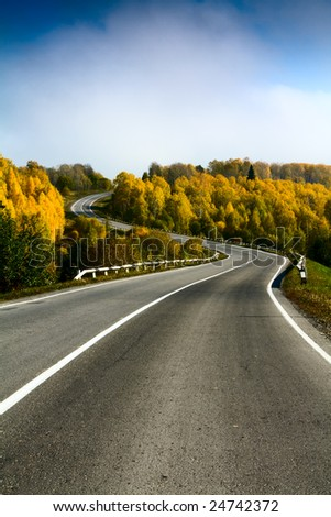 landscape with road and cloudy sky - stock photo