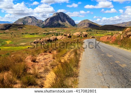 Landscape with road and rock formation in central Madagascar on a sunny day