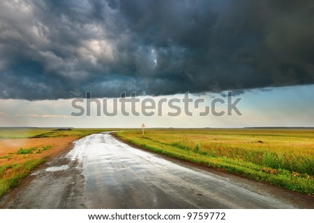 Landscape with road and storm clouds