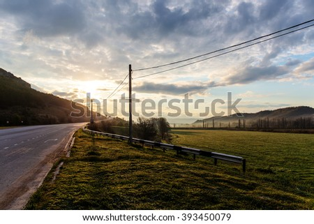 landscape with road at sunrise in spring Crimea - stock photo