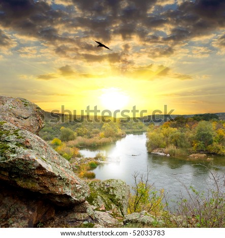 Landscape with rock and river on sunset background - stock photo