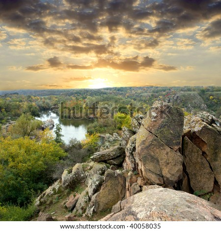Landscape with rock in forest at sunset - stock photo
