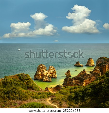 Landscape with rocks, sea and clouds.  Lagos, Portugal - stock photo