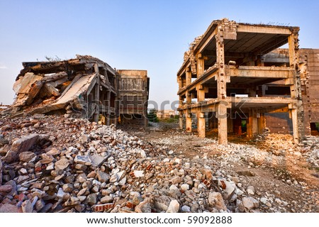 Landscape with ruins of industrial buildings at sunset - stock photo