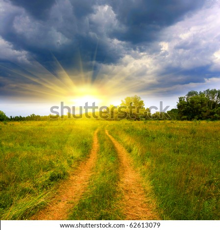 Landscape with rural road in steppe in evening time - stock photo