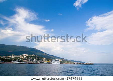landscape with seaport, ships, blue sea and sky