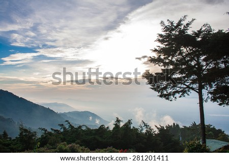 Landscape with sky blue background with mountain background and green vegetation - stock photo