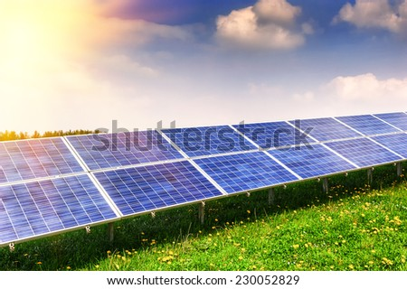 Landscape with solar energy field - stock photo