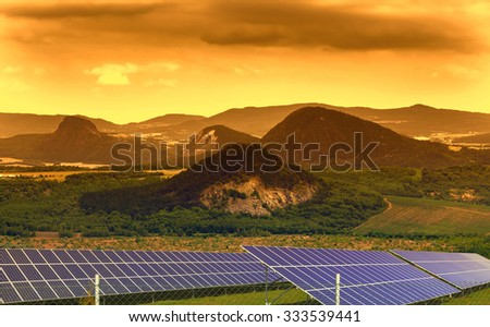 Landscape with solar panels in the sunset