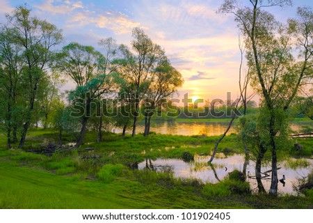 Landscape with sunrise over the Narew river, Poland. - stock photo