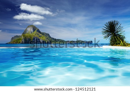 Landscape with swimming pool and Cadlao island on background, El Nido, Philippines - stock photo