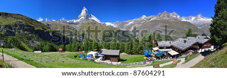 Landscape with Swisse Alps with Matterhorn and a chalet