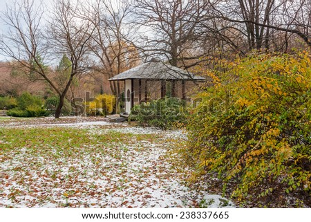 Landscape with the first snow in the autumn Japanese garden with pavilion - stock photo