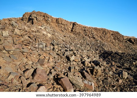 Landscape with the image of a stone quarry. varieties of clay and sand red clay green clay graphite ore under earth of careers ore different clay - stock photo