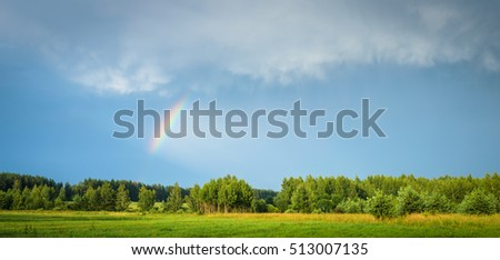 landscape with the rainbow in the sky