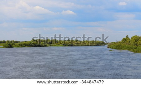 Landscape with the river on a cloudy day - stock photo