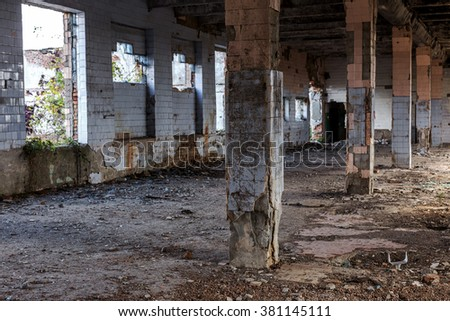 Landscape with the ruins of the old industrial factory buildings. The interior of an abandoned factory with rubble plunder and waste. The collapse of the Ukrainian economy. Odessa - stock photo