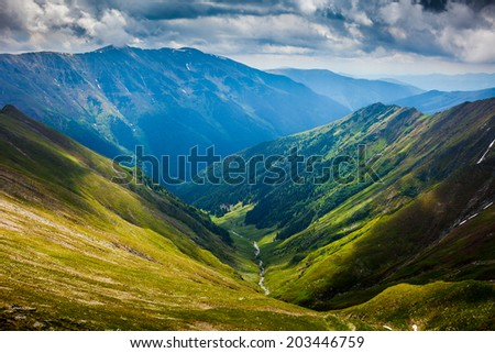 Landscape with the spectacular Fagaras mountains in Romania - stock photo