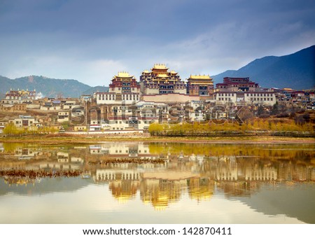 Landscape with tibetan monastery and lake - stock photo