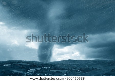 landscape with tornado in the sky in summer - stock photo